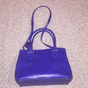 Gently carried unique blue purse.
